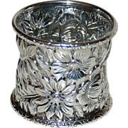 Antique Repousse Sterling Napkin Ring with an array of Blooms and Leaves