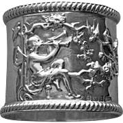 Antique Sterling Napkin Ring Depicting Fairy Playing Trumpets to attract Birds, Full Hallmarks