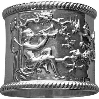 Antique English Sterling Napkin Ring with Winged Musician Playing Two Horns, Attracting Birds, Full Hallmarks