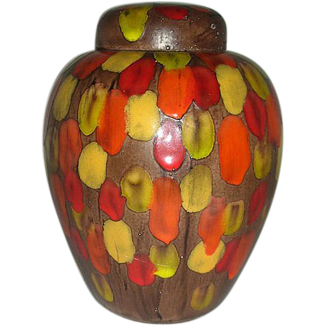 Brown ginger jar with red, orange yellow splashes