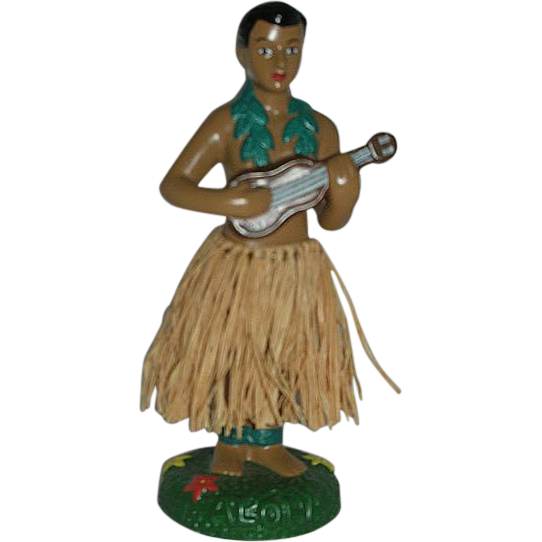 Handsome bobble waist male hula dancer
