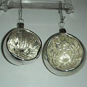 Two light silver colored indent ornaments