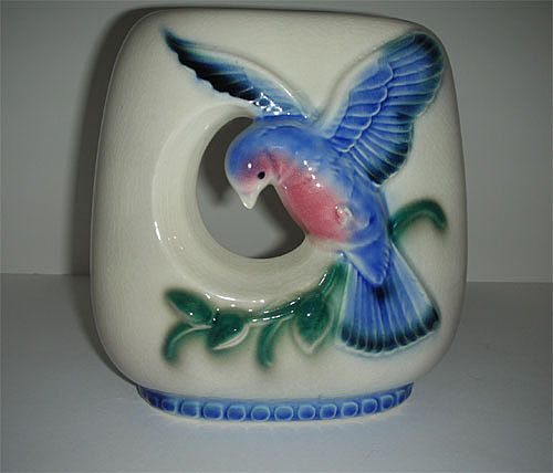 Round arcature blue bird pottery vase