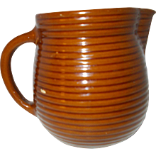 Brown   ribbed Monmouth   Pottery Company  Pitcher w/maple leaf mark