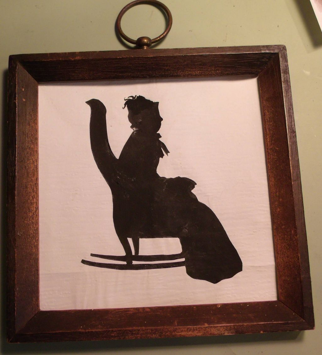 Silhouette of Lady Sitting in Rocker