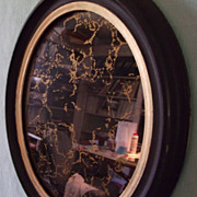 Mirror Marbleized in Gold in Oval Vintage Black Frame