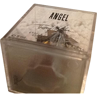 Thierry mugger Perfume. Enclosed in plastic case