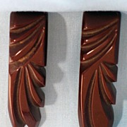 Pair of Deeply Carved Brown Bakelite Dress Clips