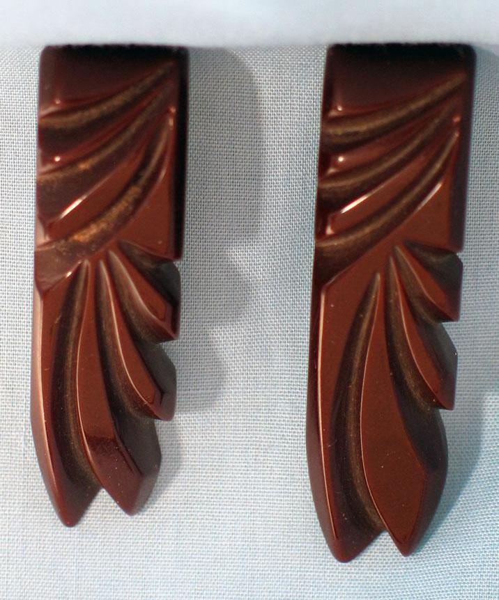 Pair of Deeply Carved Brown Bakelite Dress Clips