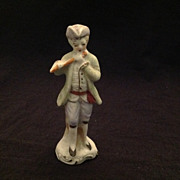 Unglazed bisque figurine man with flute Japan