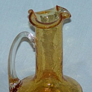 Amber crackle glass jug with threaded clear glass applied handle