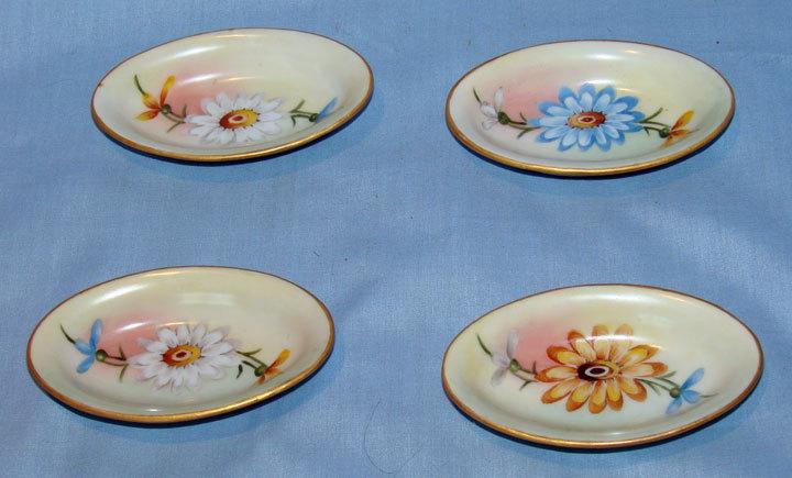 O & E.G. Royal Austria set of 4 oblong salt dips with daisies