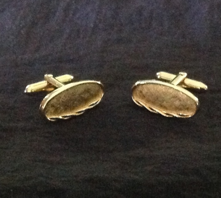 Swank gold tone oval cuff links with rope border