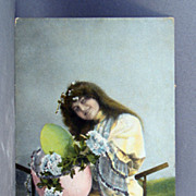 1908 Real Photo  Easter post card with girl, eggs, and flowers hand colored and trimmed with glitter