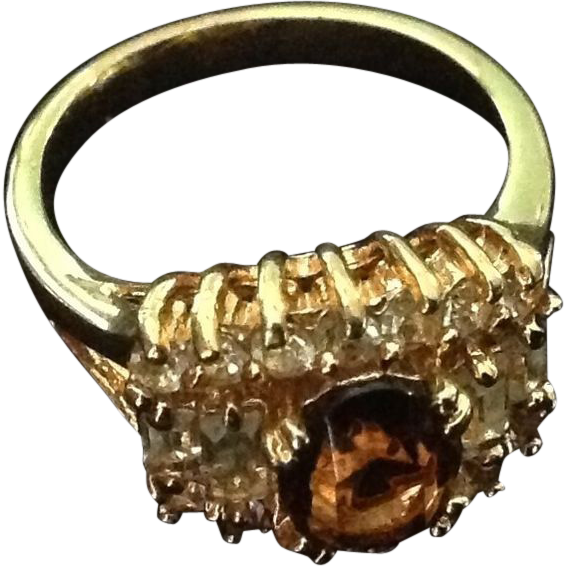 Lovely gold tone costume jewelry ring Size 5 1/2 with amber and clear rhinestones