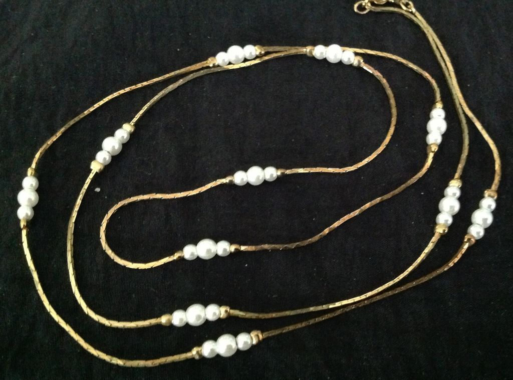 Seed pearl and gold tone necklace