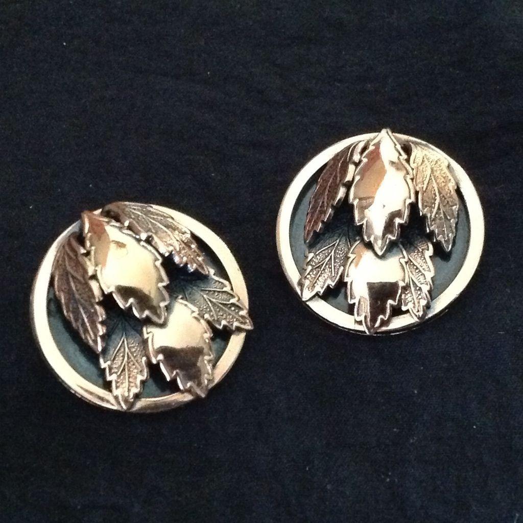 Renoir copper earrings with leaf motif