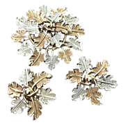 Sarah Coventry silver and gold tone oak leaf cluster pin and earrings