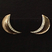 Trifari burnished gold tone crescent earrings with rhinestones