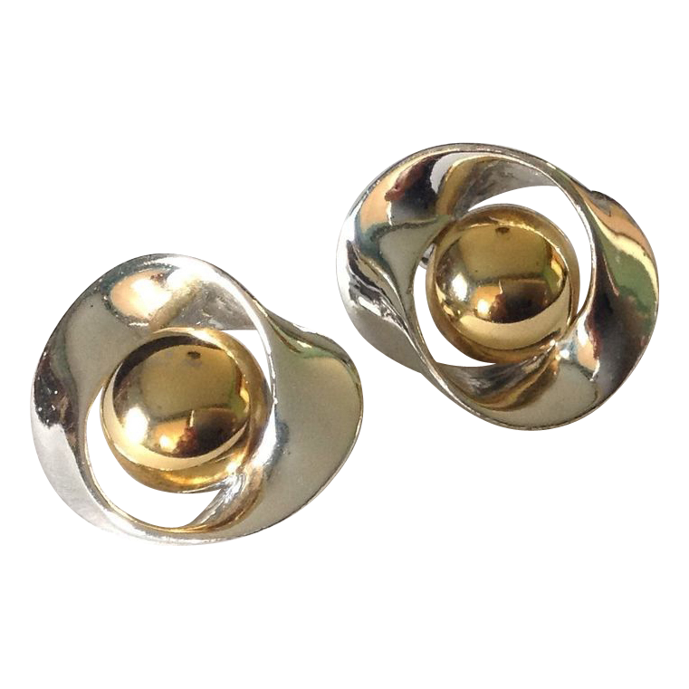 Silver tone and gold tone clip earrings