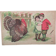 Unused Thanksgiving Day Post Card with gigantic turkey and frightened children