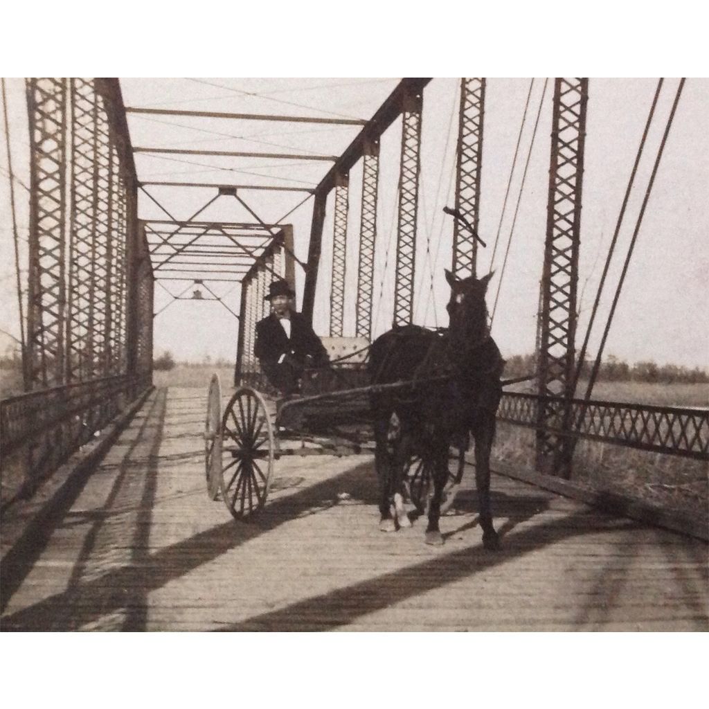 1910 Real Photo postcard Man in horse drawn carriage on bridge over White River