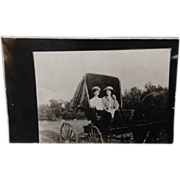 Real Photo Post Card with romantic couple in buggy