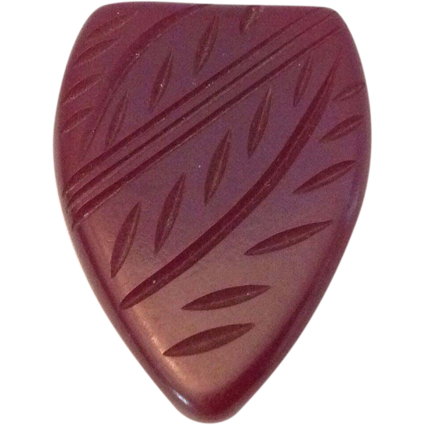 Deeply carved Bakelite dress or fur clip