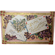 1910 Valentine with purple violets, Lily of the Valley and swastikas