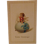 Unused Easter Greetings postcard Little boy in a sailor suit and a giant egg tied with a bow