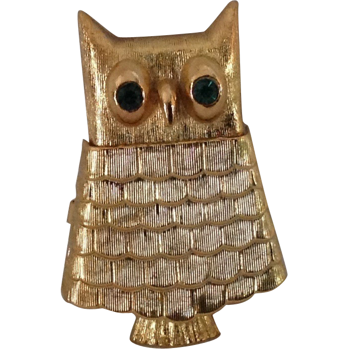 Avon Somewhere solid perfume Owl pin with green rhinestone eyes.