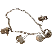 900 Silver charm bracelet with four charms