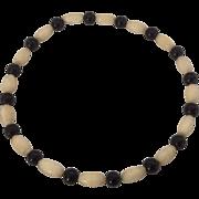 Black and cream celluloid bead bangle bracelet
