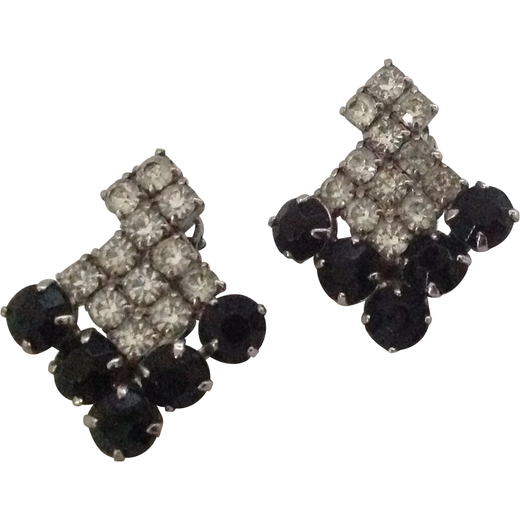 Black and clear rhinestone shield clip earrings.