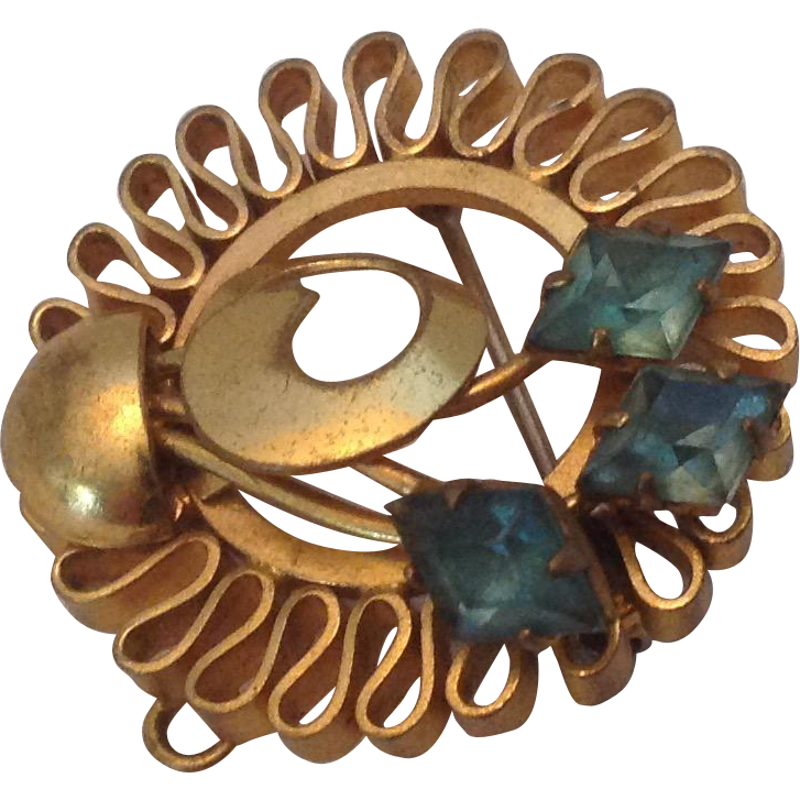 Vintage circle pin with folded border and prong set blue rhinestones with pendant loop.