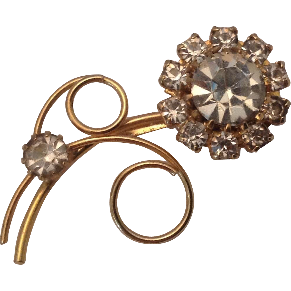 Sparkling gold tone and rhinestone flower pin