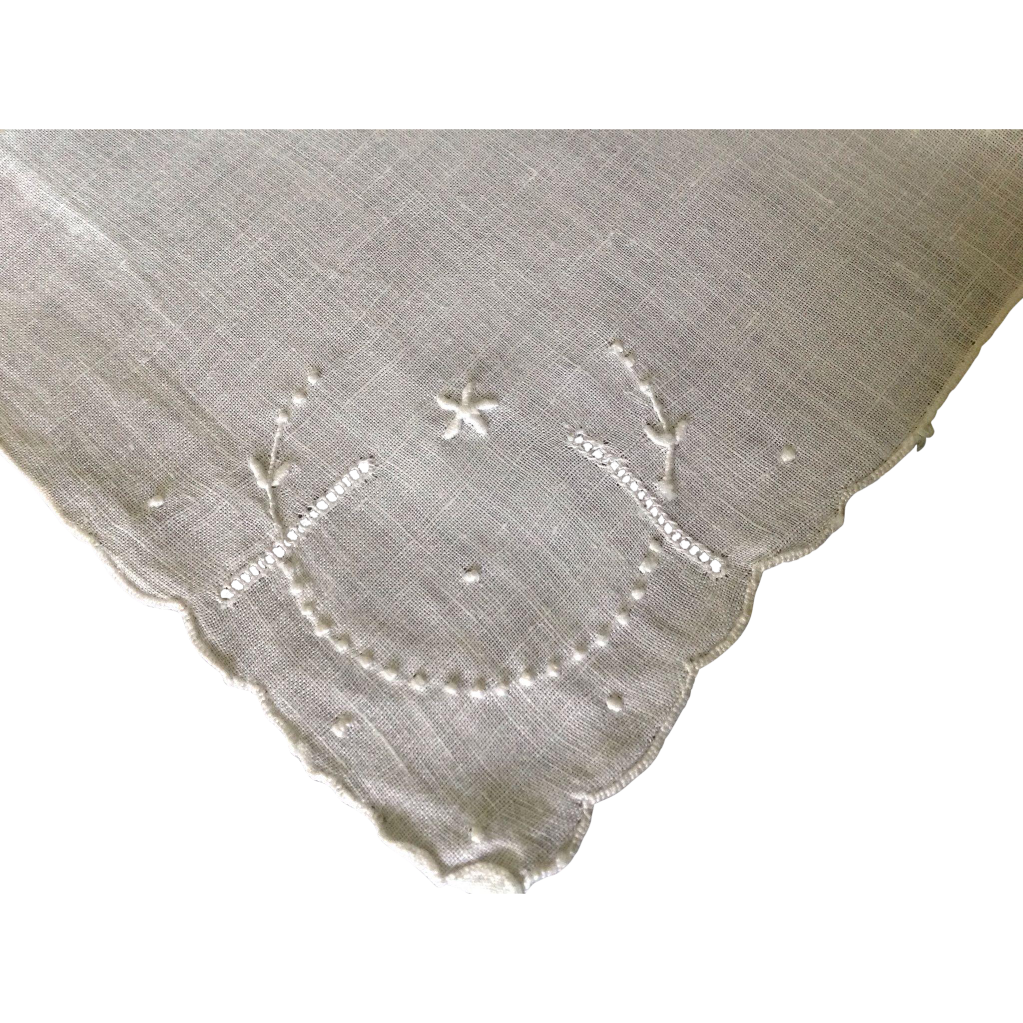 Pulled thread work and hand embroidered handkerchief