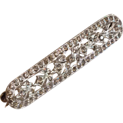 Silvertone and rhinestone bar pin