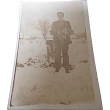 Unused Real Photo Postcard with young soldier, 2 piglets and a dog