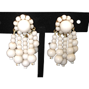 White Milk Glass Screw Back Earrings with Dangling Beaded Pendants.