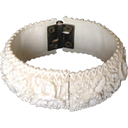 Deeply carved white celluloid clamper bracelet