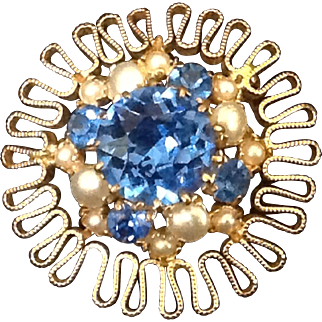 Austrian pin with deep blue rhinestones and simulated pearls in a frilled yellow metal setting.
