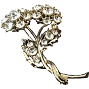 Brilliant rhinestone flower pin in gold tone setting