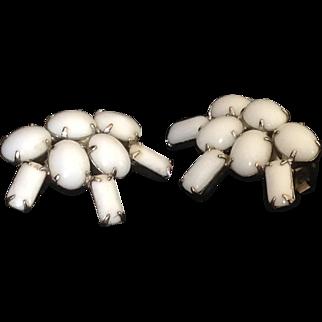 Milk glass prong set bead earrings.