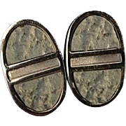 Bergere oval silver tone earrings with gray textured stone insets