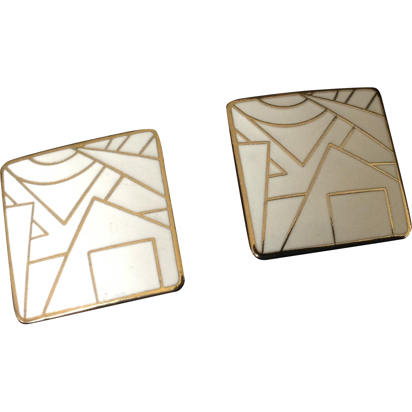 White enamel and gold tone geometric design square clip earrings.