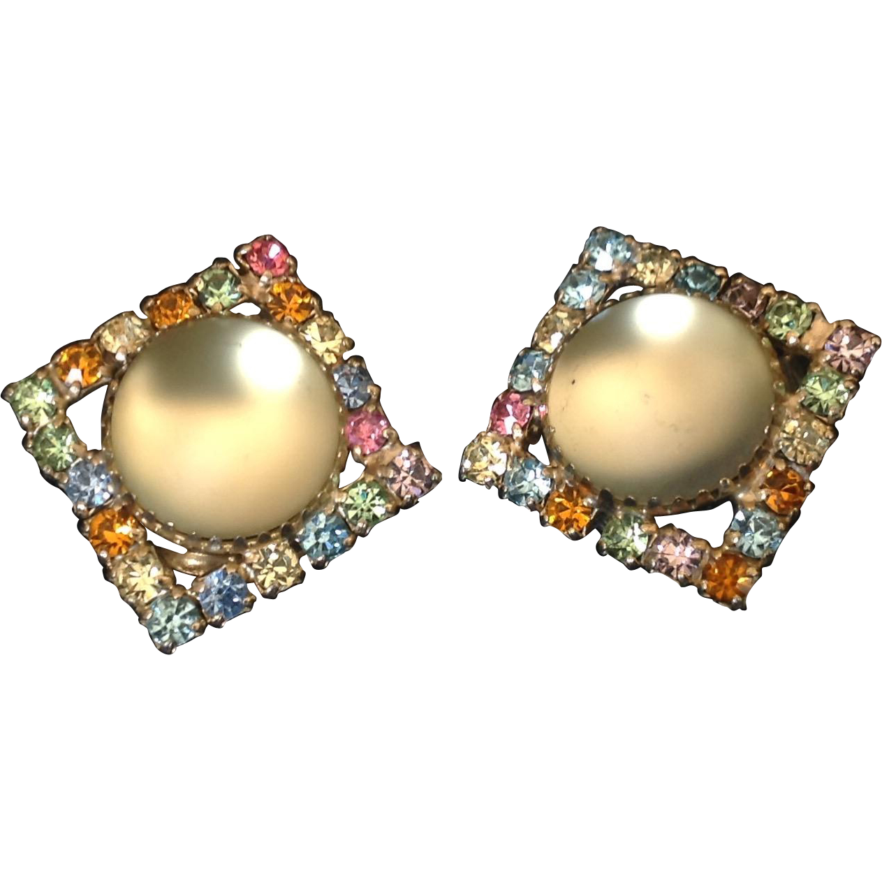 Vintage clip earrings with multi-colored prong set rhinestones around central shimmering glass cabochon