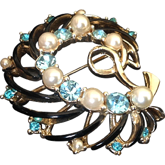 Vintage gold tone brooch with black enamel, simulated pearls and blue rhinestones