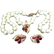 Pink rhinestone clip earrings and pendant by Roman on hand-knotted simulated pearls.