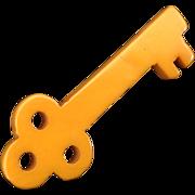 Quirky yellow Bakelite key pin